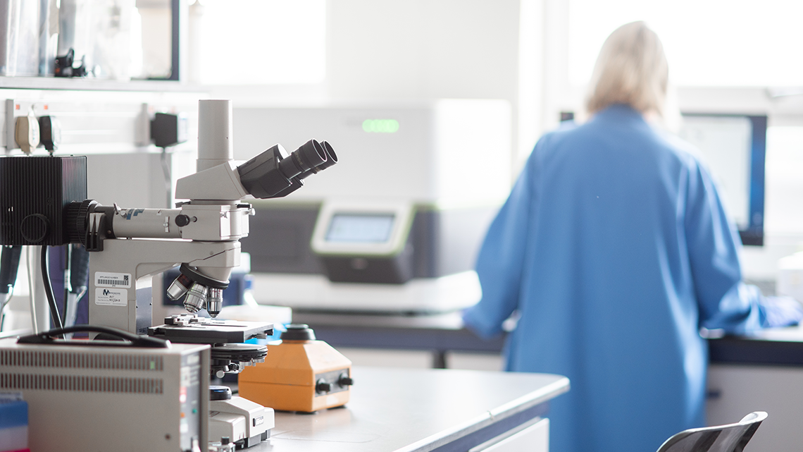Image of a laboratory with one defocused person standing behind